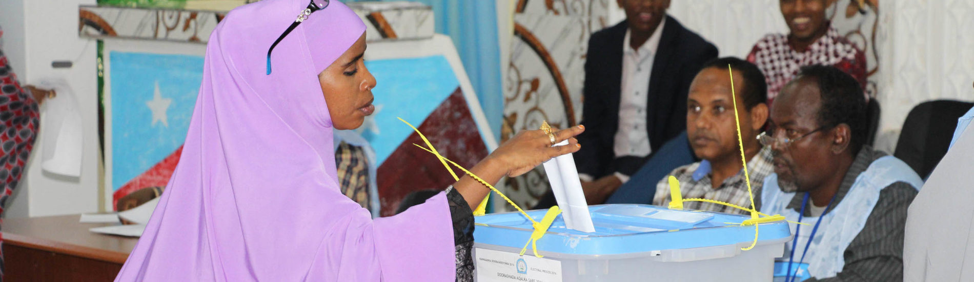 A member of the regional parliament, casts her vote during the election of the Upper House candidates in Baidoa, Somalia on October 19, 2016. AMISOM Photo / Abdikarim Mohamed